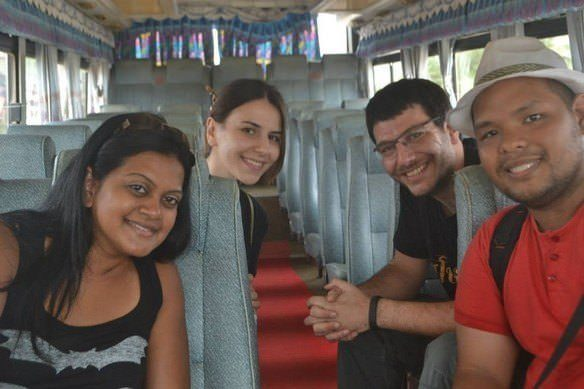 ( L-R: Park from USA, AJ from Armenia, Jim from USA and me in a bus ride to Siem Reap Terminal)