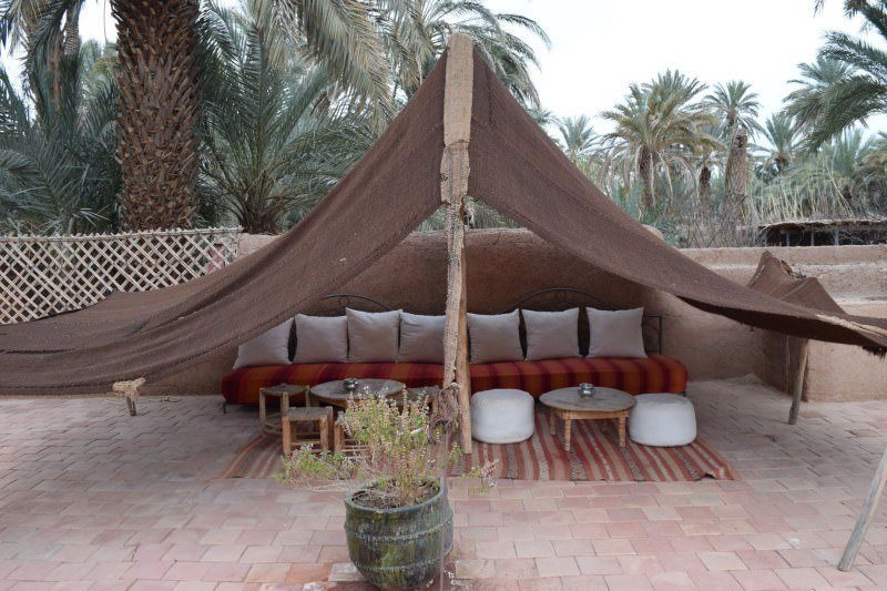 Relaxing area by the pool at Dar Qamar in Agdez, Morocco