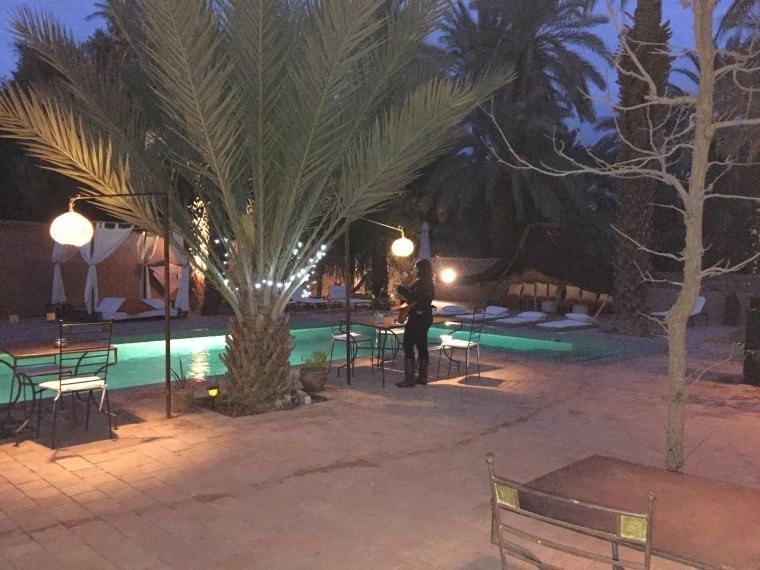 The pool area at Dar Qamar in Agdez, Morocco