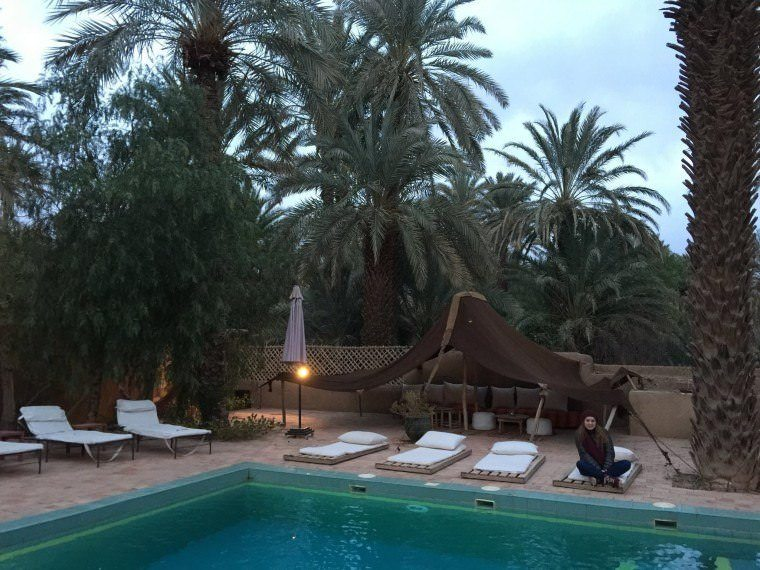 The pool area during day time at Dar Qamar in Agdez, Morocco