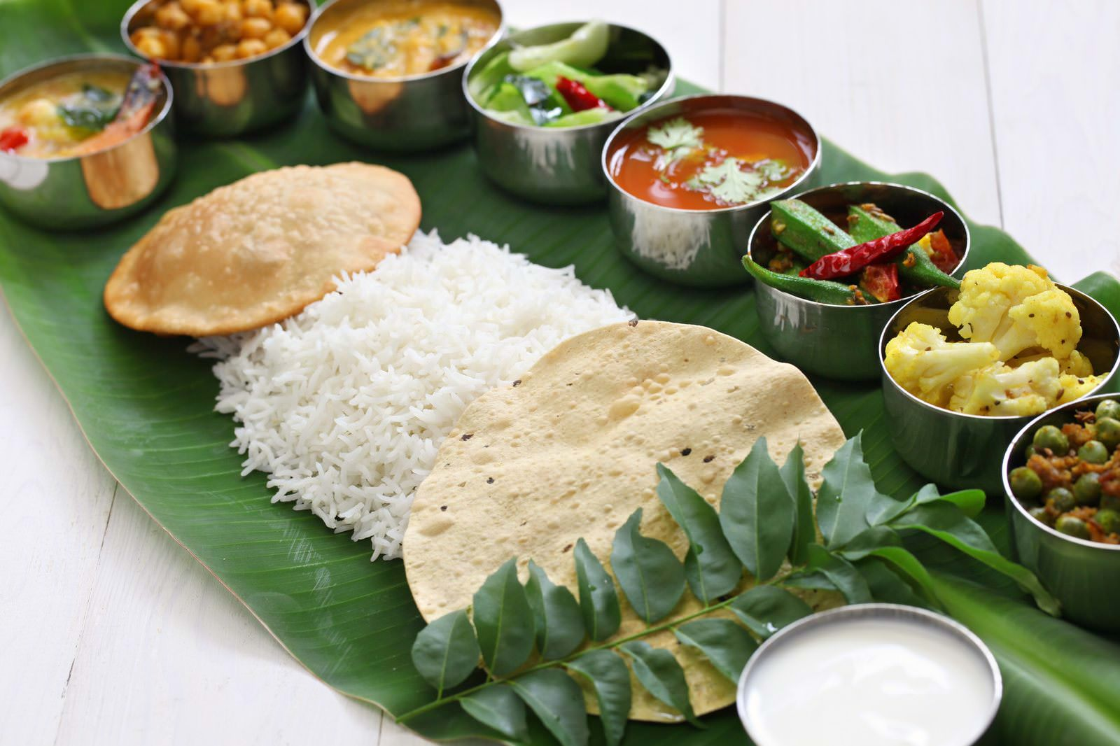 south indian meals served on banana leaf